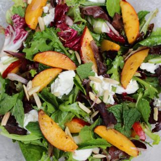 Peach Mixed Green Salad with Burrata, Cumin, and Almonds