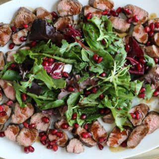 Seared Lamb Fillet with Mixed Greens and Pomegranate Dressing
