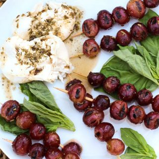 burrata with grilled grapes and basil