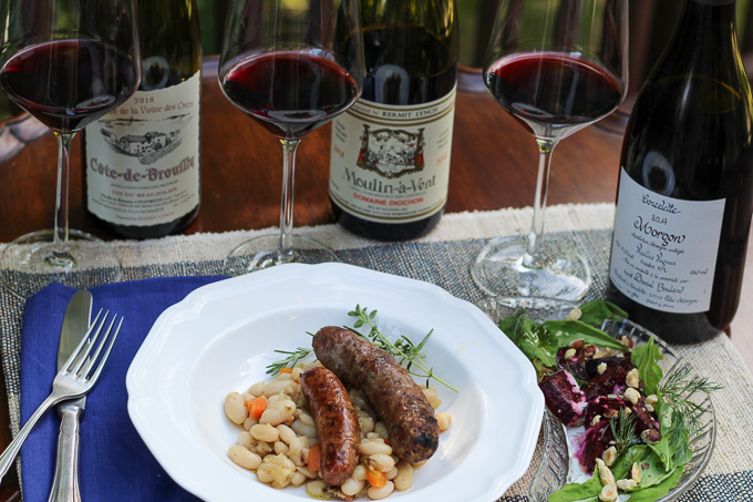 Mixed Grilled Pork Sausage Platter, French White Beans, and Beet Salad paired with Cru Beaujolais
