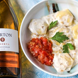 Cheese Ravioli with Two Sauces; simple tomato and creamy walnut paired with Chardonnay
