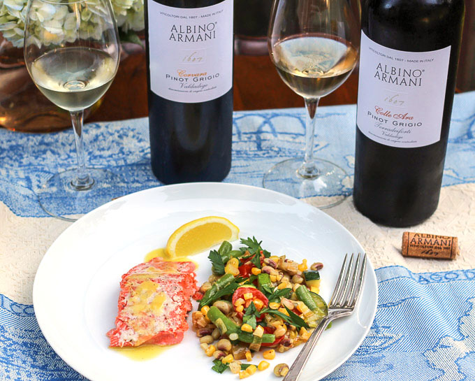 Roasted wild salmon with a southern medley of seasonal vegetables paired with Albino Armani Pinot Grigio