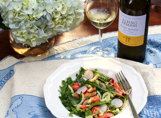 Roasted salmon with fresh arugula greens, shaved fennel, and radishes with a lemon vinaigrette paired with Albino Armani Pinot Grigio Delle Venezie DOC
